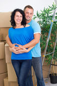 Happy couple celebrating moving to new house — Foto de Stock