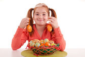 Beautiful little red-haired girl with pigtails holding Easter eg — Stock Photo