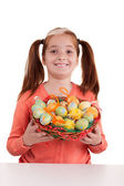 Portrait of little smiling girl with Easter eggs basket — Stock Photo