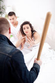 Caught cheating, angry husband holding the baseball bat, a woman — Stock Photo