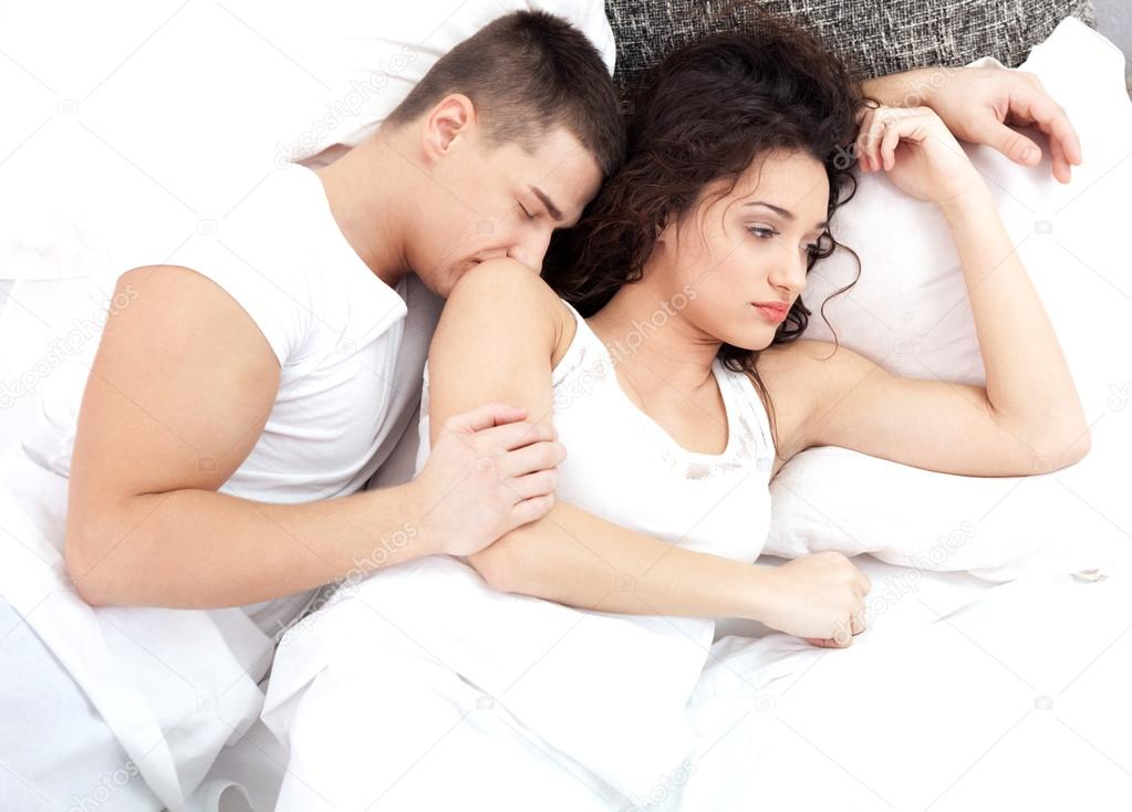 Sad woman on bed with her husband sleeping   Photo by pyotr021. Bad relationship young woman depressed about sleeping boyfriend