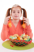 beautiful little red-haired girl with pigtails holding Easter e — Stock Photo