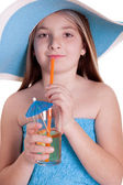 Little girl in blue summer hat drinking juice — Stok fotoğraf