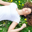 Beautiful woman sleeping with flowers outdoor  — Stock Photo #43991471