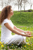 Attractive girl in one of the yoga postures close up — Stock Photo