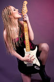 Beautiful woman punk rocker with an electric bass guitar  — Stock Photo