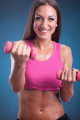 Beautiful Fitness woman doing workout with weights — Stock Photo