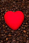 Coffee beans in burlap sack and red heart — Stock Photo