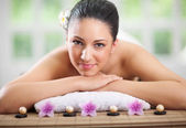 Young beautiful woman relaxing in spa center — Stock Photo