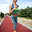 Running woman. Female runner in front of blue sky, low angle — Stock Photo #48197213