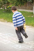 Boy on the hopscotch — Stock Photo