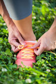 Runner trying running shoes getting ready for jogging — Stock Photo