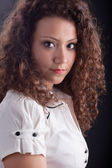 Beautiful woman with casual make up and curly hair — Stock Photo