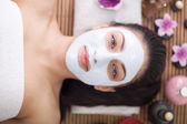 Spa therapy for young woman having facial mask at beauty salon — Stock Photo