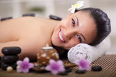 Beautiful smiling woman relaxing in spa center — Stock Photo