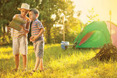 Camp in the tent - two brothers on the camping — Stock Photo