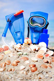 Mask, fins and tube in sand background — Stock Photo