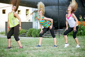 women dancing zumba, modern group choreography outdoor — Stock Photo