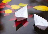 Autumn scene with paper boats — Stock Photo
