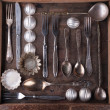 Old cutlery in a wooden box. — Stock Photo