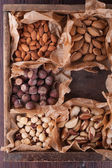 Set of nuts in a wooden box — Stock Photo