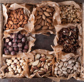Collection of nuts in a wooden box. — Stock Photo