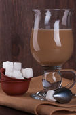 White sugar with a glass of coffee with milk — Stock Photo