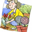 Stock Photo: Womis planting flowers