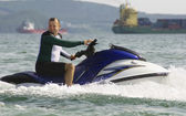Man riding a jet ski — Stock Photo