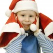 Royalty-Free Stock Photo: Girl in the hat of Santa Claus