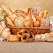 Various baked products in wicker basket — Stock Photo