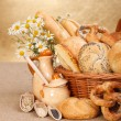 Various baked products in wicker basket — Stock Photo #12480459