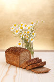 Loaf with wild flowers — Stock Photo