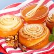 Cinnamon rolls and honey — Stock Photo