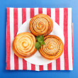 Stock Photo: Three cinnamon rolls on white plate