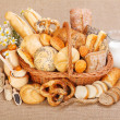Various baked products in wicker basket — Stock Photo #14149208