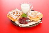 Sour cherry cake, jam and milk — Stock Photo