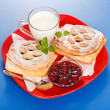 Breakfast: two sour cherry cakes, milk and jam on plate — Stok Fotoğraf #14956687