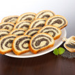 Slices of poppy seed roll slices on plate — Stock Photo