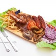 Wooden plate full of tasty food — Stock Photo
