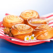 Stock Photo: Cinnamon rolls and honey