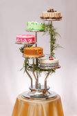 Colorful cakes on multi-storey stage — Stock Photo