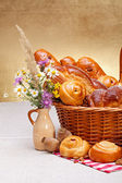 Sweet bakery products in basket — Stock Photo