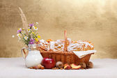 Sweet cakes in basket, fruit and milk decoration — Stock Photo
