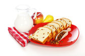 Slices of sweet loaf with raisins and milk — Stock Photo