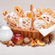 Stock Photo: Sweet cakes in basket, fruit and milk decoration