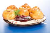 Sour cherry cakes and jam — Stock Photo