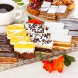 Various sweet cakes on oblong plate — Stock Photo