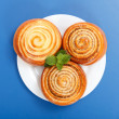 Three cinnamon rolls on white plate — Photo