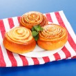 Three cinnamon rolls on white plate - Stock Photo